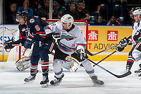 KELOWNA, CANADA - APRIL 4: Dallas Valentine #6 of Kamloops Blazers is checked by Tanner Wishnowski on April 4, 2016 at Prospera Place in Kelowna, British Columbia, Canada.  (Photo by Marissa Baecker/Shoot the Breeze)  *** Local Caption ***