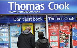 FILE PICTURE © Licensed to London News Pictures. 22/11/2011..Redcar, Cleveland..A couple take a look for holiday offers in the window of Thomas Cook in Redcar in Cleveland...Photo credit : Ian Forsyth/LNP