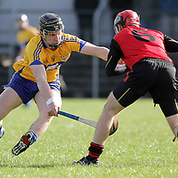 Clare's John Conlon puts Down's Connor Woods under pressure as he tries to clear his lines in Round 4 of the Allianz Hurling League @ Cusack Park. - Photograph by Flann Howard