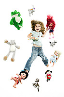 caucasian little girl surrounded by toys isolated studio on white background