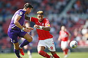 Middlesbrough forward Britt Assombalonga (9) and Stoke City defender Danny Batth (14) contest a loose ball  during the EFL Sky Bet Championship match between Middlesbrough and Stoke City at the Riverside Stadium, Middlesbrough, England on 19 April 2019.