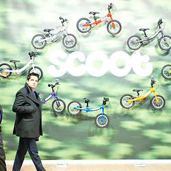 London, UK - 17 January 2013:  visitors pass by the Scoot stand during the London Bike show 2013 at the Excel.