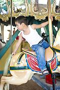 Tito Cruz on Pullen Park's Carousel.