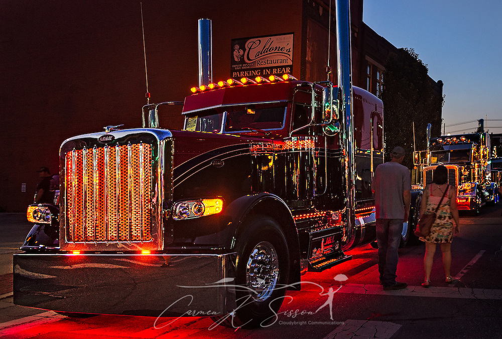 "J&L Contractors' 2015 Peterbilt 389, ""Contender,"" participates in the light show contest during the 34th annual Shell Rotella SuperRigs. SuperRigs, organized by Shell Oil Company, is an annual beauty contest for working trucks. Approximately 89 trucks entered this year's competition. (Photo by Carmen K. Sisson/Cloudybright)"