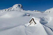 Stone structure nearly buried by winter snows, North Cascades washington