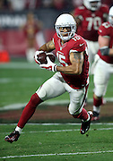 Arizona Cardinals wide receiver Michael Floyd (15) looks for yards after a catch on a 9 yard pass completion that gives the Cardinals a first down at the Green Bay Packers 34 yard line on a third down play in the fourth quarter during the NFL NFC Divisional round playoff football game against the Green Bay Packers on Saturday, Jan. 16, 2016 in Glendale, Ariz. The Cardinals won the game in overtime 26-20. (©Paul Anthony Spinelli)