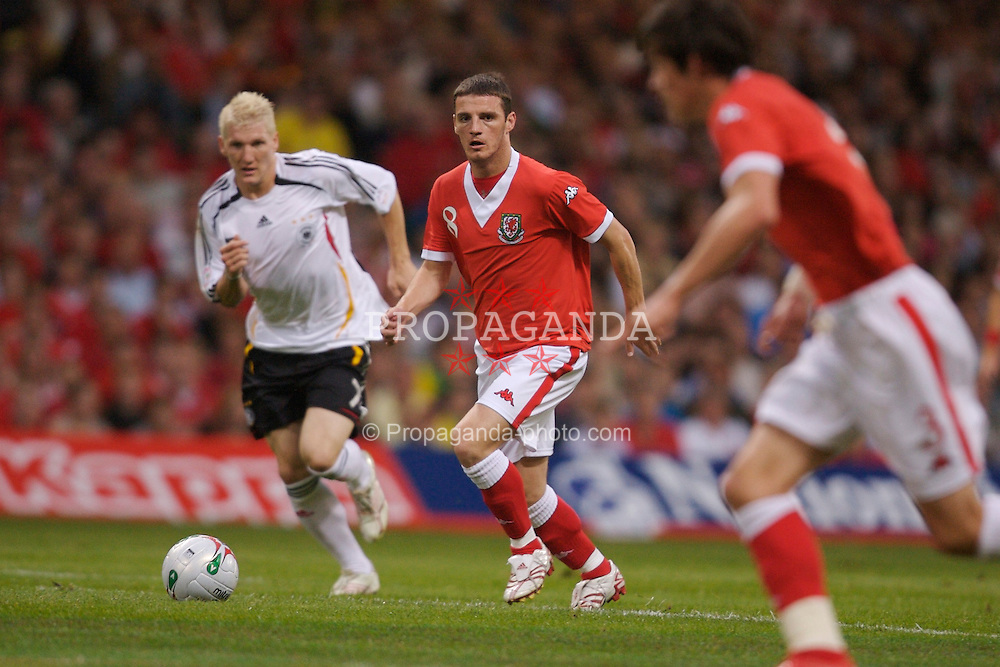Cardiff, Wales - Saturday, September 8, 2007: Wales' Jason Koumas and Germany's Bastian Schweinsteiger during the Euro 2008 Qualifying Group D match at the Millennium Stadium. (Photo by David Rawcliffe/Propaganda)