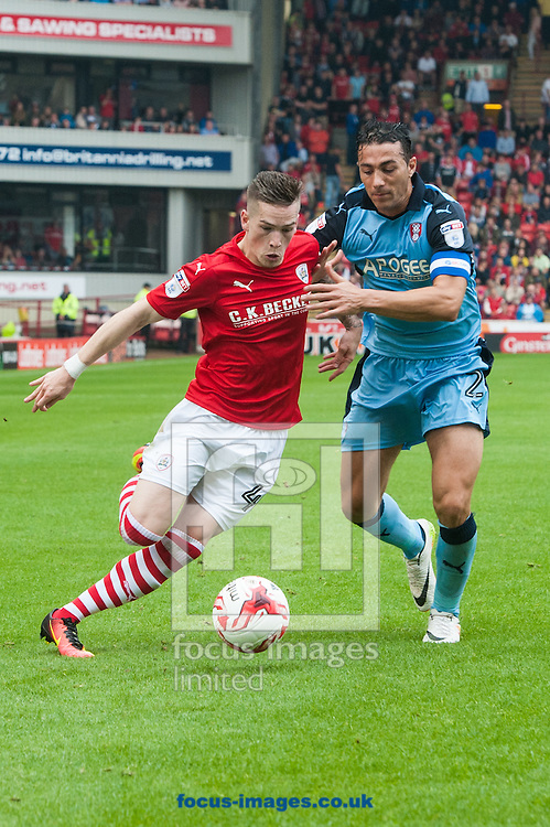Ryan Kent of Barnsley tries to find a way past Stephen Kelly of Rotherham United during the Sky Bet Championship match at Oakwell, Barnsley<br /> Picture by Matt Wilkinson/Focus Images Ltd 07814 960751<br /> 27/08/2016