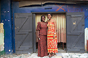 Njideka Harry (right), director of Youth for Technology, pictured here with Joy, outside her restaurant.<br />