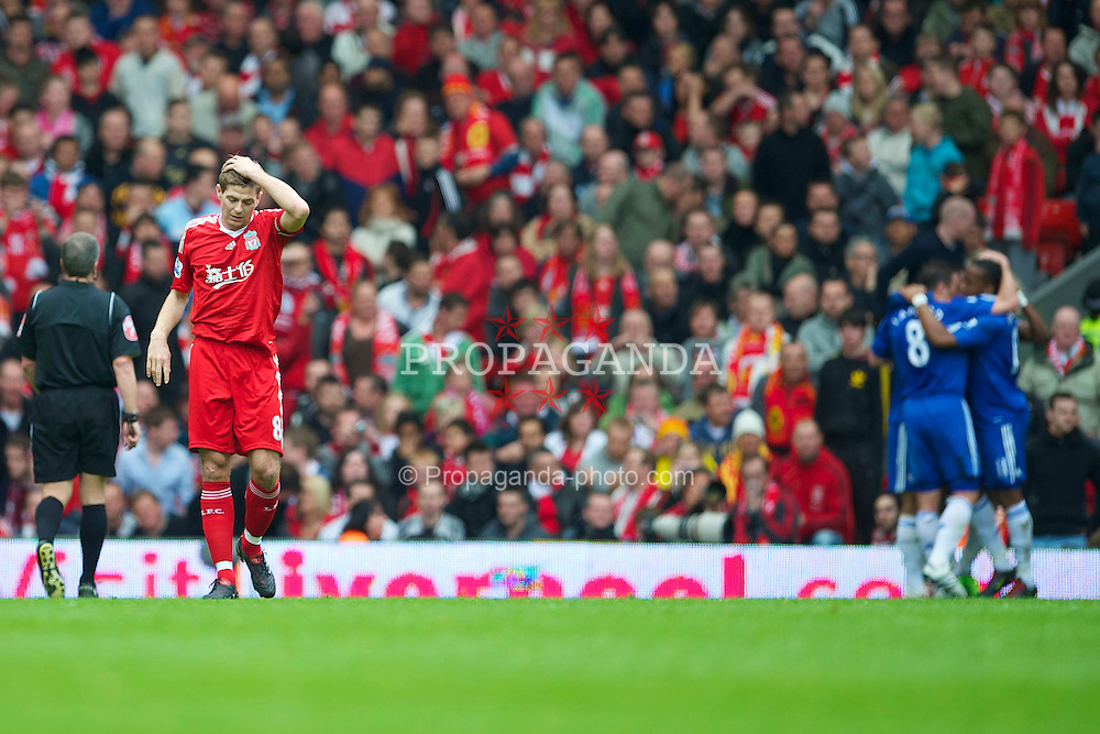 LIVERPOOL, ENGLAND - Sunday, May 2, 2010: Liverpool's captain Steven Gerrard MBE looks dejected after a poor back-pass led to Chelsea's opening goal during the Premiership match at Anfield. (Photo by David Rawcliffe/Propaganda)
