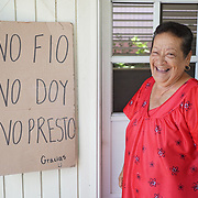 AUGUST 27, 2018--SAN JUAN---PUERTO RICO--<br /> Carmen Milagros Rivera Ortiz, 72, stands in the partially rebuilt house in the Ca&ntilde;o Martin Pe&ntilde;a neighborhood of San Juan. Her niece travels regularly to do a lot of the construction work. The sign warns customers to her soda stand that she doesn't give, lends or lets folks buy with IOUs.<br /> (Photo by Angel Valentin/Freelance)