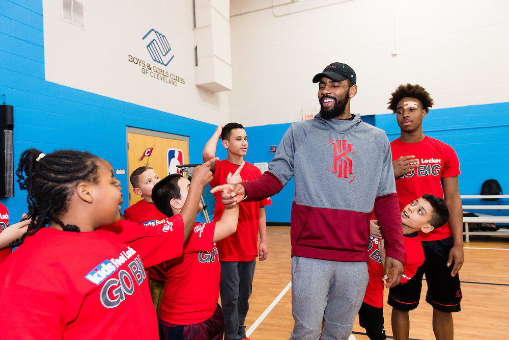 NBA star Kyrie Irving interacts with Club kids during the Kids Foot Locker Fitness Challenge kickoff event at Boys & Girls Clubs of Cleveland on Friday, Jan. 20, 2017, in Cleveland. (Jason Miller/AP Images for Kids Foot Locker)