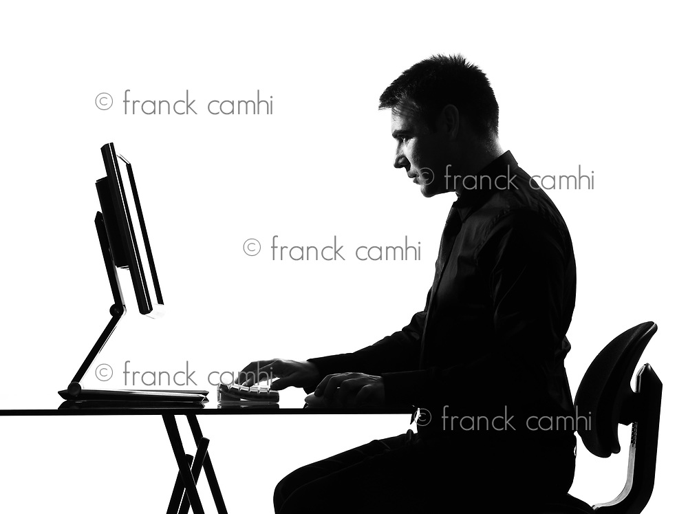 silhouette caucasian serious business man  computing  on studio isolated white background