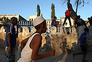Children are photographed playing in Stone Town in Zanzibar, Tanzania.