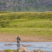 Tómas guðmundsson fly fishing at the pool Efri Beljandi on the river Breiðdalsá, Iceland.