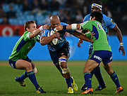 PRETORIA, South Africa, 18 MAY 2013 : Lionel Mapoe of the Bulls is tackled by Fumiaki Tanaka (right) and Hayden Parker of the Highlanders during the SupeRugby match between the BULLS and the HIGHLANDERS at Loftus Versfeld in Pretoria, South Africa on 18 MAY 2013. Bulls 35 - 18 Highlanders.<br /> <br /> © Anton de Villiers / SASPA