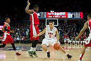 DALLAS, TX - JANUARY 21: Nic Moore #11 of the SMU Mustangs drives to the basket against the Rutgers Scarlet Knights on January 21, 2014 at Moody Coliseum in Dallas, Texas.  (Photo by Cooper Neill/Getty Images) *** Local Caption *** Nic Moore