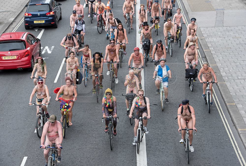 "© Licensed to London News Pictures.  <br /> 17/06/2018; Bristol, UK. The World Naked Bike Ride through Bristol city centre, including a stop to dance to in the park. The event sees hundreds of naked and near naked cyclists cycle around Bristol city centre to campaign for improved cycle routes in Bristol and to raise awareness of the dangers and vulnerability cyclists in the city face on a daily basis. The event included a symbolic ""die-in"" to commemorate the 23 cyclists that have been killed on Bristol's roads. Photo credit: Simon Chapman/LNP"