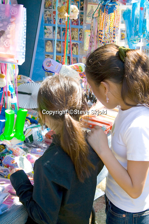 Hmong children trying to decide on the purchase at concession stand. Hmong Sports Festival McMurray Field St Paul Minnesota USA