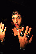 Man posing for camera, displaying the rings on his hands, UK, 2000