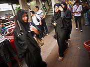 06 JULY 2011 - BANGKOK, THAILAND: Arab women walk along Sukhumvit Road next to Soi Arab in Bangkok. Soi Arab is an alleyway in Bangkok. What started as an alley has now grown into a neighborhood that encompasses several blocks of restaurants, hotels and money exchanges that cater to Middle Eastern visitors to Thailand. The official name of the street is Sukhumvit Soi 3/1, located in North Nana between Sukhumvit Soi 3 and Sukhumvit Soi 5, not far from the Nana Plaza night-life area and the Grace Hotel popular among Arabs.   PHOTO BY JACK KURTZ