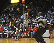 "Ole Miss guard Chris Warren (12)  shoots at C.M. ""Tad"" Smith Coliseum in Oxford, Miss. on Saturday, December 4, 2010."