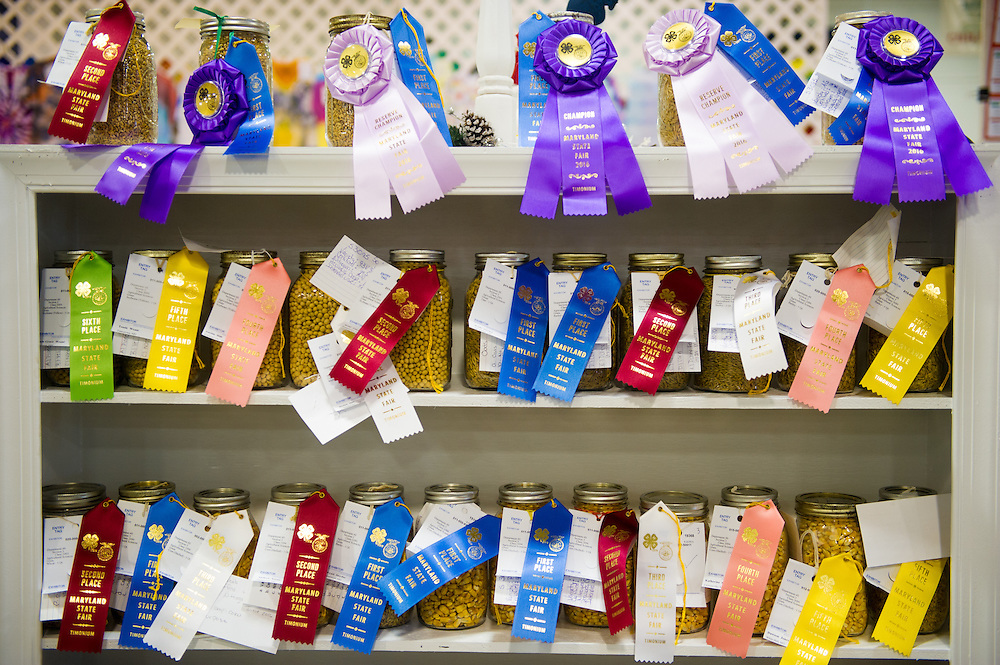 Timonium, Maryland - jars of decorated winning and placing corn sit upon a shelf at the 2016 Maryland State Fair.
