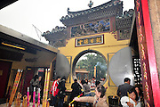 Asia, Southeast, People's Republic of China, Macau People light incense at the entrance to the A-Ma Temple
