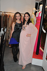 Left to right, LAMA EL MOATASSEM and CARMEN HAID at a dinner hosted by Carmen Haid at Atelier Mayer, 47 Kendal Street, London W2 on 21st February 2012.