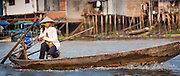 Woman driving a boat on Mekong Delta (Vietnam)