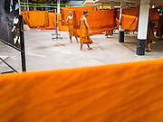 07 APRIL 2013 - CHIANG MAI, CHIANG MAI, THAILAND:  Buddhist novices hang their robes to dry after washing them at Wat Chedi Luang in Chiang Mai, Thailand. Wat Chedi Luang is the most important temple in Chiang Mai and was the main temple of the Lanna Kingdom, before it was absorbed by Thailand, then Siam, in the late 18th century. Chiang Mai is the largest town in northern Thailand and is popular with tourists and backpackers.       PHOTO BY JACK KURTZ