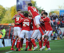 Swindon Town's Michael Smith celebrates with his team mates after scoring a goal - Photo mandatory by-line: Dougie Allward/JMP - Mobile: 07966 386802 - 11/05/2015 - SPORT - Football - Swindon - County Ground - Swindon Town v Sheffield United - Sky Bet League One - Play-Off