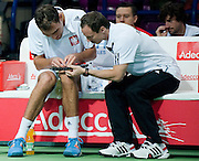 (L) Jerzy Janowicz &amp; (R) Radoslaw Szymanik - captain national team while break on the bench during the BNP Paribas Davis Cup 2014 between Poland and Croatia at Torwar Hall in Warsaw on April 6, 2014.<br /> <br /> Poland, Warsaw, April 6, 2014<br /> <br /> Picture also available in RAW (NEF) or TIFF format on special request.<br /> <br /> For editorial use only. Any commercial or promotional use requires permission.<br /> <br /> Mandatory credit:<br /> Photo by &copy; Adam Nurkiewicz / Mediasport