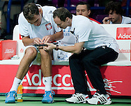 (L) Jerzy Janowicz & (R) Radoslaw Szymanik - captain national team while break on the bench during the BNP Paribas Davis Cup 2014 between Poland and Croatia at Torwar Hall in Warsaw on April 6, 2014.<br /> <br /> Poland, Warsaw, April 6, 2014<br /> <br /> Picture also available in RAW (NEF) or TIFF format on special request.<br /> <br /> For editorial use only. Any commercial or promotional use requires permission.<br /> <br /> Mandatory credit:<br /> Photo by © Adam Nurkiewicz / Mediasport