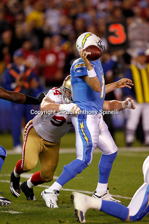 San Francisco 49ers defensive tackle Justin Smith (94) hits San Diego Chargers quarterback Philip Rivers (17) as he releases the ball and throws an incomplete pass during the NFL week 15 football game against the San Diego Chargers on Thursday, December 16, 2010 in San Diego, California. The Chargers won the game 34-7. (©Paul Anthony Spinelli)