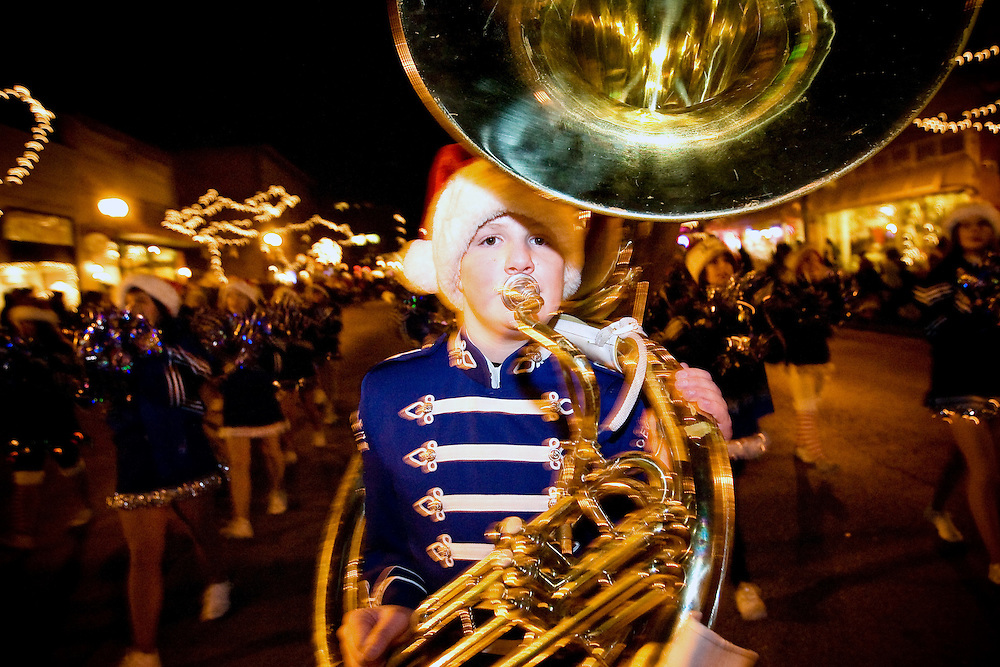 JEROME A. POLLOS/Press..Chris Myers, 14, brings up the rear of the Coeur d'Alene High School band with his tuba during Friday's holiday light show parade.
