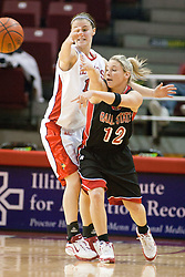 06 December 2006: Kristi Cirone reaches past Kiley Jarrett in an attempt to block a pass. In a non-conference game, the Cardinals of Ball State visited the Redbirds home at Redbird Arena in Normal Illinois on the campus of Illinois State University.<br />