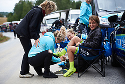 Valentina Scandolara (ITA) has a little trouble fitting her overshoes at Ladies Tour of Norway 2018 Team Time Trial, a 24 km team time trial from Aremark to Halden, Norway on August 16, 2018. Photo by Sean Robinson/velofocus.com