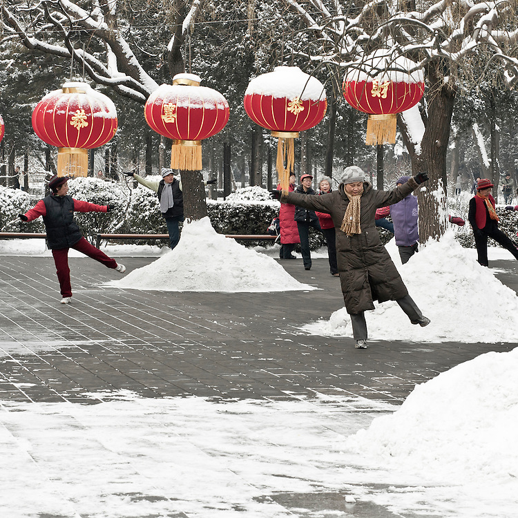 A group of woman is performing his daily health-dance in the Coal Hill park (Jingshan park), near the Forbidden city , after a snowfall that local authorities say they have provoked on Beijing in order to fight the drought in northern China. Fe? 13 2011