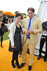 LILY ALLEN and JO THORNTON MD Veuve Clicquot UK at the 2011 Veuve Clicquot Gold Cup Final at Cowdray Park, Midhurst, West Sussex on 17th July 2011.