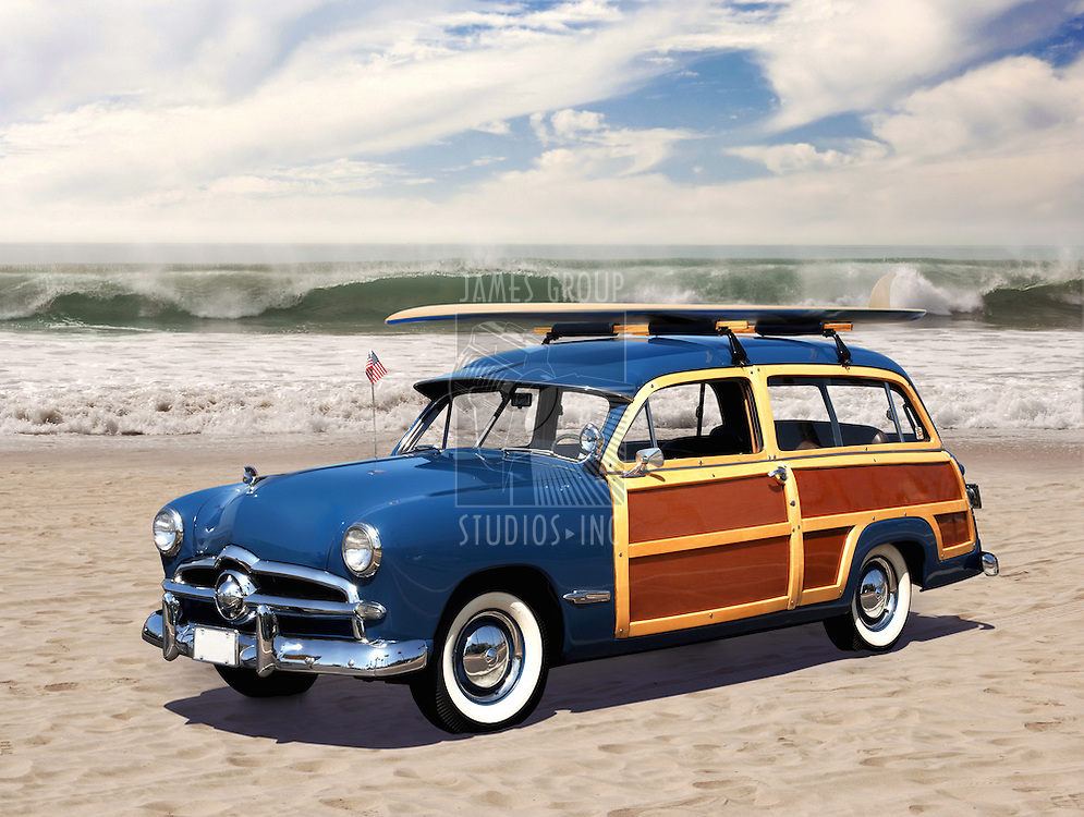 vintage woodie car with surfboard on the roof parked on the beach with waves in the background