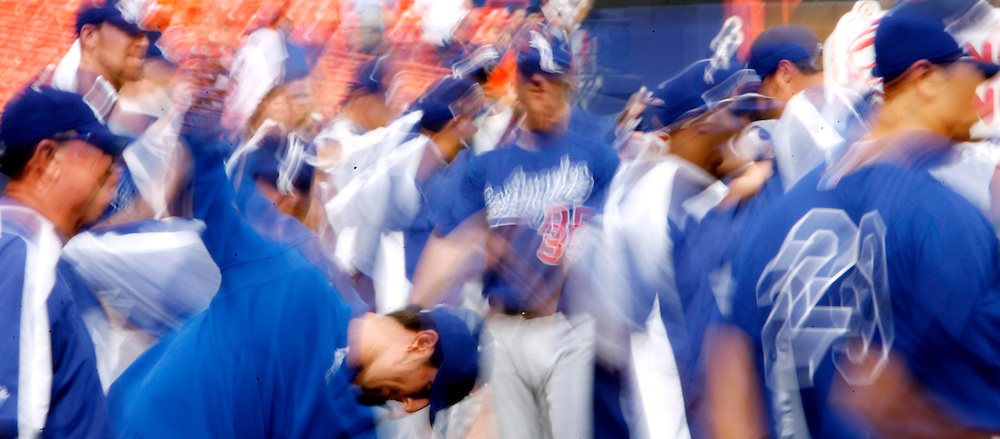 Members of the Los Angeles Dodgers stretch during batting practice before the start of the National League Division Series at Shea Stadium on Wednesday 04 October 2006.