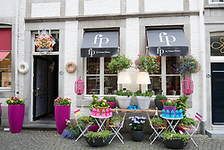 Attractive shop front in historic city of Maastricht in The Netherlands