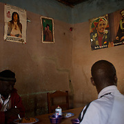 January 19, 2013 - Niono, Mali: Locals take lunch at a restaurant with Kaddafi, Bob Marley and Emperor Haile Selassiei posters displayed in the back walls. Niono village is the last government controlled location before Diabaly, a city under islamist militants control since the 14th of January.<br />