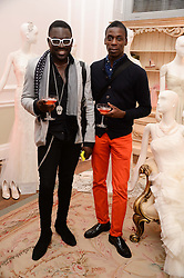 VIPs, taste-makers, socialites and brides-to-be flocked to 29 Portland Place for the launch of the Quintessentially Weddings Atelier. Presenting a unique experiential showcase of every element to make the ultimate wedding a success, Quintessentially Weddings Atelier brought together the world's finest wedding artisans for the discerning, style conscious bride and groom.<br /> Guests enjoyed delicious canapés from Harrods as well as the stunning 'Wedding Cocktail' created by The Connaught's head barman Agostino Perroni using Quintessentially Vodka.<br /> Picture shows:-AIZAK BUYONDO, LEROY DAWKINS.