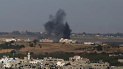 May 4, 2019 - Gaza, gaza strip, Palestine - Amoke billows above buildings during an Israeli airstike on Gaza City on May 4, 2019. - Gaza militants fired a barrage of dozens of rockets at Israel, which responded with strikes that killed a Palestinian today, officials said, as a fragile ceasefire again faltered. (Credit Image: © Majdi Fathi/NurPhoto via ZUMA Press)
