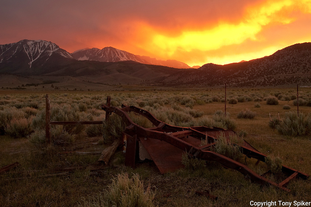 """Tioga Pass Sunset 1"" - A photograph of a rusted chassis at sunset off of Highway 395, near Lee Vining, California"