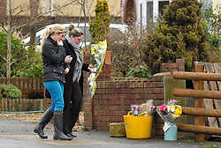 © Licensed to London News Pictures. File pic dated 28/01/2013. Bristol, UK. Flowers being left at the scene where Ross and Clare Simons  were killed when the tandem bike they were riding was hit by a car. Nicholas Lovell, who was driving the car that knocked them off their tandem bike today admitted two counts of causing death by dangerous driving. Photo credit : Simon Chapman/LNP