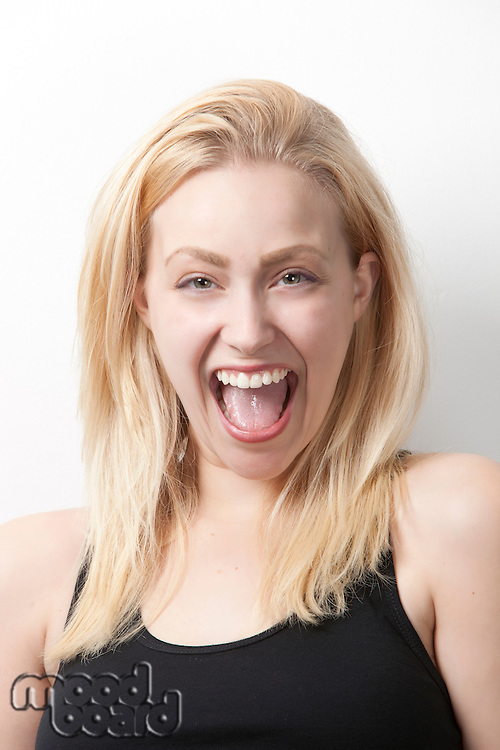 Portrait of cheerful young Caucasian woman against white background