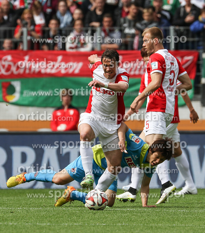02.05.2015, SGL Arena, Augsburg, GER, 1. FBL, FC Augsburg vs 1. FC Koeln, 31. Runde, im Bild Markus Feulner (FC Augsburg #8) setzt sich durch gegen Yuya Osako (1. FC Koeln), Ragnar Klavan (FC Augsburg #5, re.), // during the German Bundesliga 31th round match between FC Augsburg and 1. FC Cologne at the SGL Arena in Augsburg, Germany on 2015/05/02. EXPA Pictures &copy; 2015, PhotoCredit: EXPA/ Eibner-Pressefoto/ Krieger<br /> <br /> *****ATTENTION - OUT of GER*****